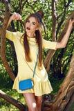 Beautiful sexy woman brunette walk in park sun shine dress Stock Photos