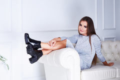 Beautiful sexy woman brunette wear in a grey dress Stock Photo