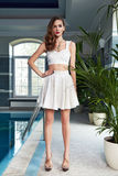Beautiful sexy woman catalog summer collection clothes pool Royalty Free Stock Photos