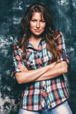 Beautiful sexy woman in check shirt. In studio Stock Photos