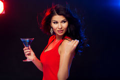 Beautiful sexy woman with cocktail at nightclub Stock Photography
