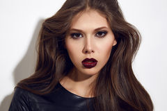Beautiful sexy woman color makeup bordo lips dark eyes cosmetics Royalty Free Stock Image