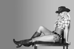 Beautiful sexy woman with cowboy hat. Beautiful young woman in cowboy hat Royalty Free Stock Photo