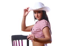 Beautiful sexy woman cowgirl on white Royalty Free Stock Image