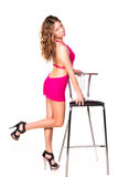 Beautiful sexy woman dancing with bar chair Royalty Free Stock Photo