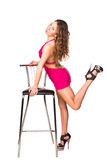 Beautiful sexy woman dancing with bar chair Stock Photo