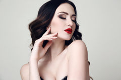 Beautiful sexy woman with dark hair and bright makeup Stock Photos