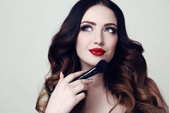 Beautiful sexy woman with dark hair and bright makeup Stock Photography