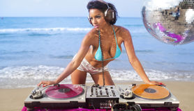Beautiful sexy woman dj at beach Royalty Free Stock Photography