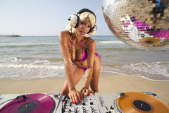 Beautiful sexy woman dj at beach Royalty Free Stock Images