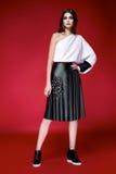 Beautiful woman dress clothes collection catalogue. Beautiful young business woman brunette hair evening makeup wearing dress suit top skirt high heels shoes stock photos