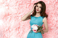 Beautiful sexy woman in dress many flowers makeup summer spring Stock Image