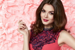 Beautiful woman in dress many flowers makeup summer spring