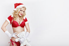 Beautiful and sexy woman dresses as a sexy santa claus Royalty Free Stock Photography