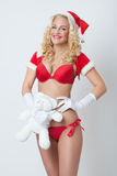 Beautiful and sexy woman dresses as a sexy santa claus Stock Photo