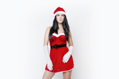 Beautiful and sexy woman dresses as a sexy santa claus Stock Photography