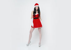 Beautiful and sexy woman dresses as a sexy santa claus Royalty Free Stock Image
