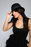 Beautiful sexy woman in elegant dress and hat Royalty Free Stock Image