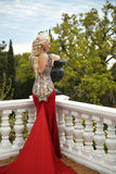 Beautiful sexy Woman with elegant hair style in mermaid red dres Stock Photography
