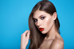 Beautiful sexy woman with evening makeup red lips long hair hand Royalty Free Stock Image
