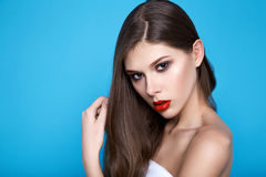 Beautiful sexy woman with evening makeup red lips long hair hand Royalty Free Stock Photo