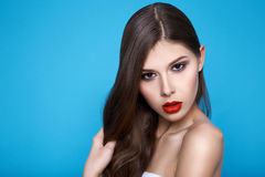 Beautiful sexy woman with evening makeup red lips long hair hand Stock Photo
