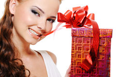 Beautiful sexy woman face with a christmas gift Royalty Free Stock Image