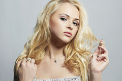 Beautiful sexy woman.Flirt Blond Girl with Curly hair Royalty Free Stock Photo