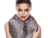 Beautiful woman in furs makeup makeup jewelry stock photography