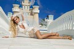 Beautiful woman in an elegant evening gown, stands against the background of a fountain and palace in the Caribbean. Beautiful sexy woman girl in an elegant stock photos