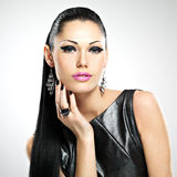 Beautiful woman with glamour fashion makeup of eyes and gl. Face of the beautiful woman with glamour fashion makeup of eyes and gloss hairstyle. Portrait of the stock photography
