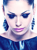 Beautiful  woman with glamour fashion makeup of eyes and gl Stock Photos