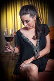 Beautiful sexy woman with glass of wine thinking Stock Photos