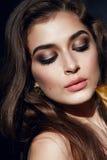 Beautiful sexy woman golden makeup brunett pink lips Stock Photography