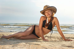 Beautiful woman in hat and bikin Stock Photography