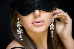 Beautiful sexy woman. her eyes closed mask. Royalty Free Stock Photo