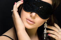 Beautiful sexy woman. her eyes closed mask. Stock Photography