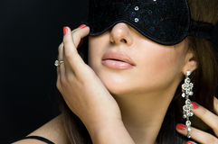 Beautiful sexy woman. her eyes closed mask Stock Photo