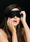 Beautiful sexy woman. her eyes closed mask Royalty Free Stock Images