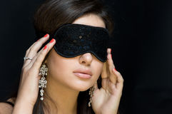 Beautiful sexy woman. her eyes closed mask. Royalty Free Stock Photos