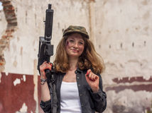 Beautiful sexy woman holding army weapon Stock Photo