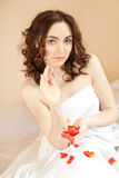 Beautiful sexy woman holding a rose petals Royalty Free Stock Photos
