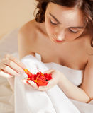 Beautiful woman holding a rose petals (focus on hands) Royalty Free Stock Photography