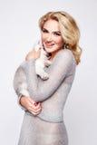 Beautiful sexy woman hug pets dog makeup dress blond Stock Photography