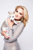 Beautiful sexy woman hug pets dog makeup dress blond Royalty Free Stock Photos