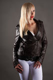 Beautiful woman in a jacket licking lips Stock Photo