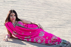 Beautiful Sexy Woman Laying in Desert Stock Images