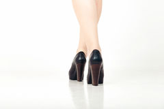 Beautiful sexy woman legs with black high heels. Sexy woman long legs in high heels Isolated over white background Royalty Free Stock Photography