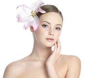 Beautiful woman with lily on the head Stock Photos