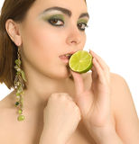 Beautiful sexy woman with lime in her hand Royalty Free Stock Photo